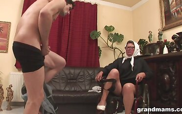 Horny four eyed granny fucks a young man and she has a super charged sex drive