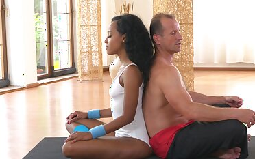 Ebony babe is set to devour slay rub elbows with man's big white during Yoga class