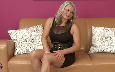 Mature blue eyed blonde Lexa licks a dildo before insertion