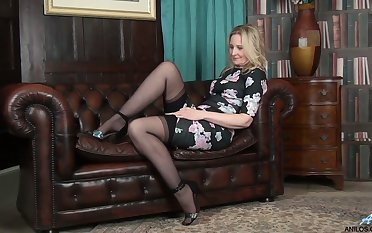 Lecherous mature blonde Emma Turner is carrying-on with her sex-starved snatch