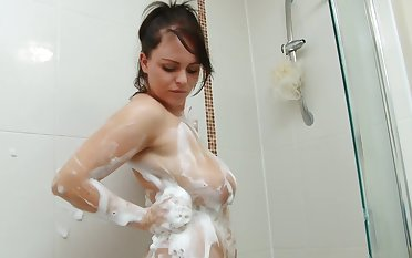 Curvy young floosie soaps up their way plunder in the shower