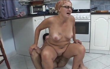 Shagging on hammer away kitchen flabbergast with matured amateur Ela with glasses